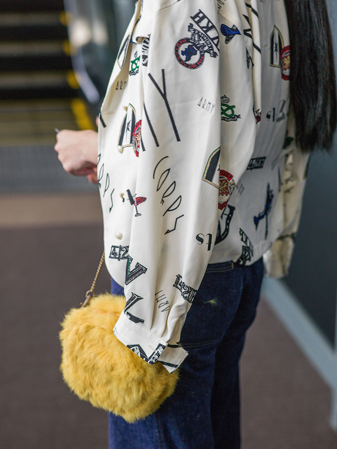 TOKYO, JAPAN - MARCH 19: A guest is seen wearing vintage shirt and jeans and thrift-store yellow clutch handbag during the Mercedes Benz Fashion Week TOKYO 2015 A/W at Shibuya Hikarie on March 19, 2015 in Tokyo, Japan. (Photo by Alfie Goodrich/Getty Images)